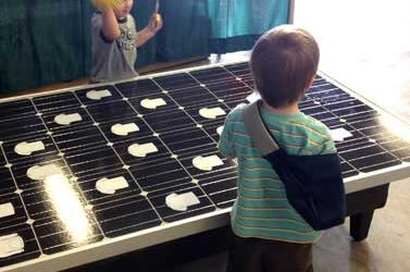 JRE brings a ray of sunshine to the 2013 Michigan Energy Fair